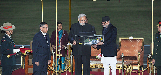 Prime Minister hands over a model of ALH Dhruv to Prime Minister Sushil Koirala at Kathmandu