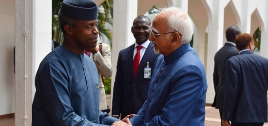 The Vice President, Shri M. Hamid Ansari being received by the Vice President of Nigeria, Mr. Yemi Osinbajo at the State House, in Abuja, Nigeria